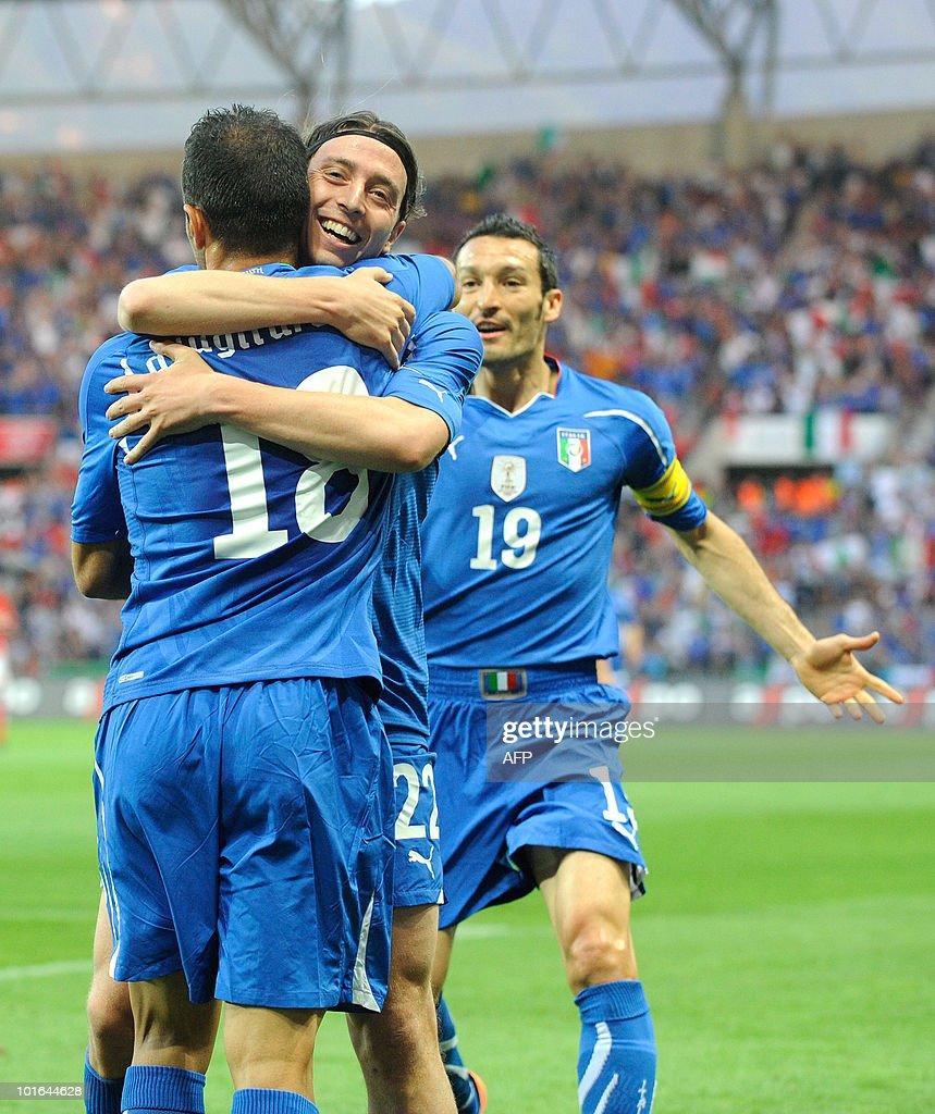 The italians Riccardo Montolivo (C) and Gianluca Zambrotta (R) congratulate Fabio Quagliarella (L) after he scored the first Italian goal during the Switzerland vs Italy friendly match on June 5, 2010 at La Praille stadium in Geneva.