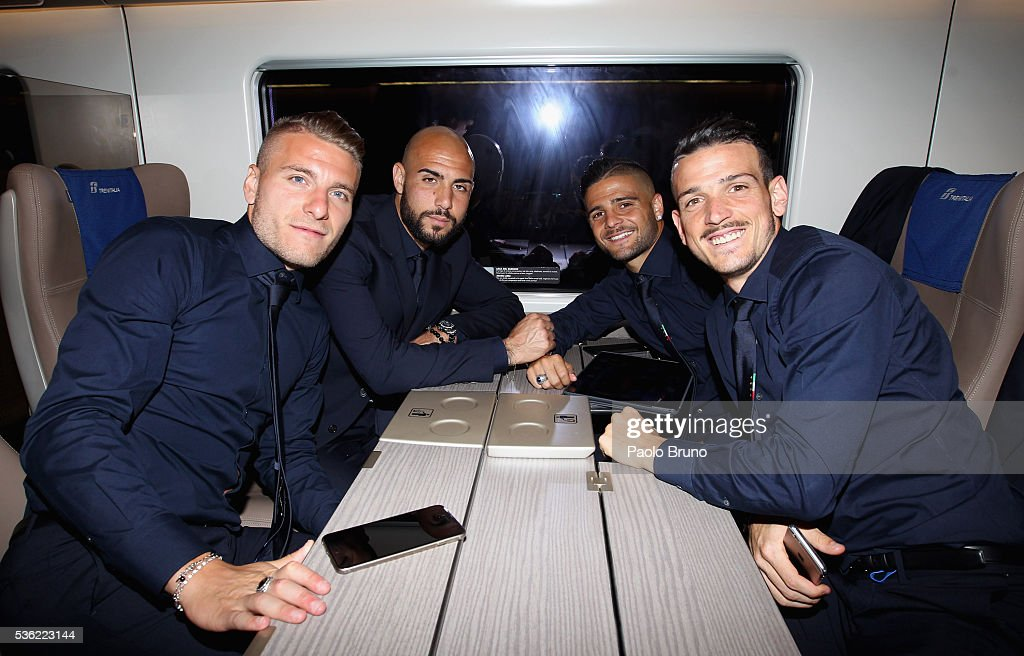 The Italy players <a gi-track='captionPersonalityLinkClicked' href=/galleries/search?phrase=Ciro+Immobile&family=editorial&specificpeople=5820229 ng-click='$event.stopPropagation()'>Ciro Immobile</a>, Simone Zazza, <a gi-track='captionPersonalityLinkClicked' href=/galleries/search?phrase=Lorenzo+Insigne&family=editorial&specificpeople=7486481 ng-click='$event.stopPropagation()'>Lorenzo Insigne</a> and <a gi-track='captionPersonalityLinkClicked' href=/galleries/search?phrase=Alessandro+Florenzi&family=editorial&specificpeople=7349992 ng-click='$event.stopPropagation()'>Alessandro Florenzi</a> depart for Coverciano on the Frecciarossa 1000 train at Stazione Termini on May 31, 2016 in Rome, Italy.