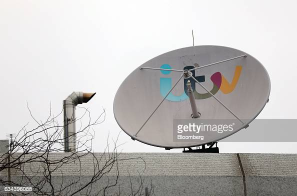 The ITV Plc company logo sits on a satellite dish outside the company's headquarters and television studios in London UK on Thursday Feb 9 2017 ITV...