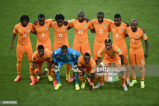 The Ivory Coast pose for a team photo before the 2014 FIFA World Cup Brazil Group C match between the Ivory Coast and Japan at Arena Pernambuco on...