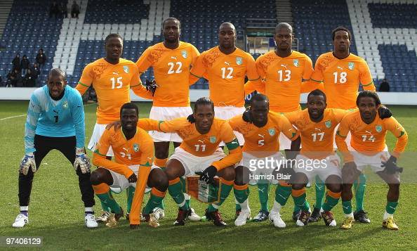 The Ivory Coast team pose for a photo ahead of the International Friendly match between Ivory Coast and Republic of Korea played at Loftus Road on...