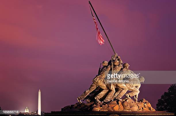 CONTENT] The Iwo Jima Memorial also known as the US Marine Corps War Memorial in the foreground with Capitol Hill and the Washington Monument...