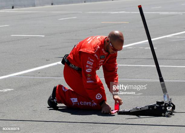 The jack man for Kyle Larson marks out his jack point during the NASCAR Monster Energy Cup Series Toyota/Save Mart 350 on June 25 2017 at Sonoma...
