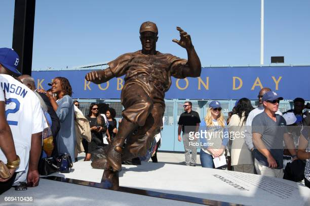 The Jackie Robinson statue is unveiled before the game between the Arizona Diamondbacks and the Los Angeles Dodgers at Dodger Stadium on Saturday...