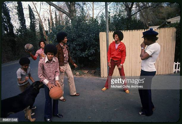 The Jackson brothers play basketball in the backyard of their home Los Angeles 1972 From left to right Randy Jackson Marlon Jackson Michael Jackson...
