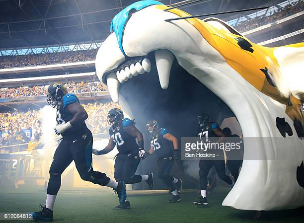 The Jacksonville team run out on to the pitch ahead of the NFL International Series match between Indianapolis Colts and Jacksonville Jaguars at...