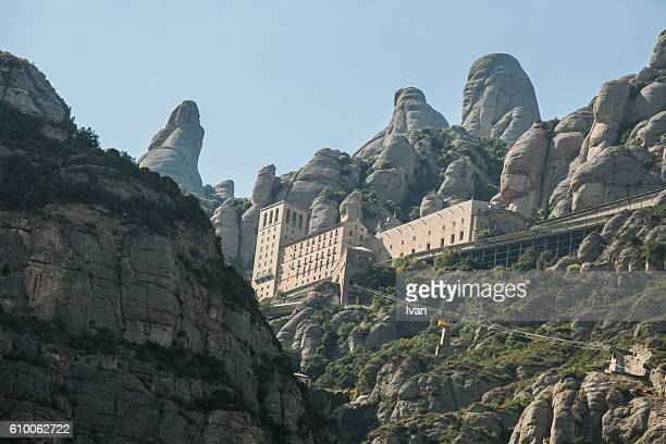 The jagged mountains in Catalonia with Cable Car (Aeri de Montserrat), Spain, showing the Benedictine Abbey at Montserrat, Santa Maria de Montserrat, near Barcelona