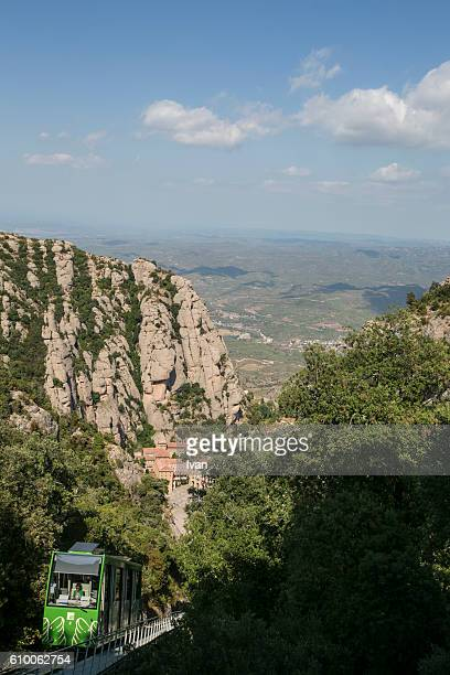 The jagged mountains in Catalonia withCremallera Funicular (Rack Train), Spain, showing the Benedictine Abbey at Montserrat, Santa Maria de Montserrat, near Barcelona