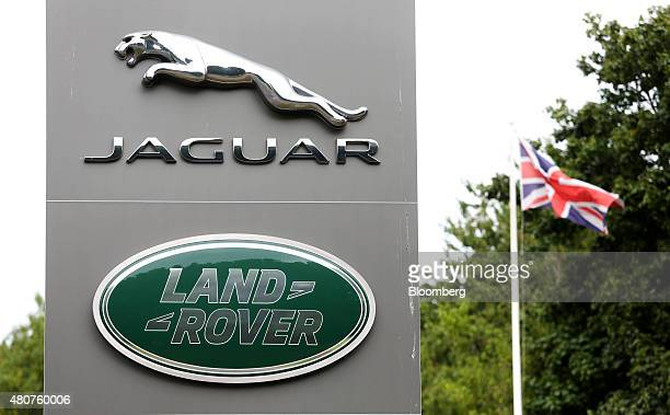The Jaguar and Land Rover company logos sit on a sign at the entrance to Tata Motors Ltd's Jaguar Land Rover vehicle manufacturing plant in Solihull...