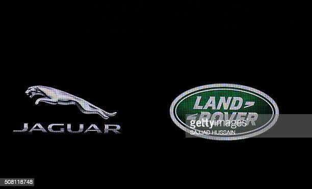 The Jaguar and Land Rover logo is seen at the Indian Auto Expo 2016 in Greater Noida on the outskirts of New Delhi on February 3 2016 India's...