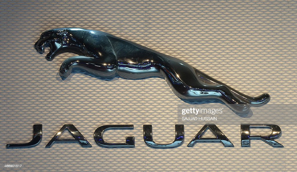 The Jaguar logo is pictured at the 12th Auto Expo in Greater Noida on February 5 2014 AFP PHOTO/ SAJJAD HUSSAIN