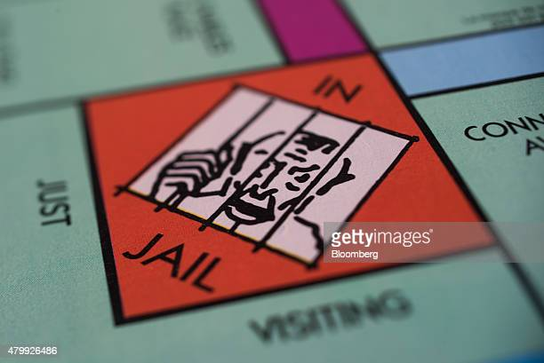 The 'Jail' square is seen on a Hasbro Inc Monopoly board game arranged for a photograph taken with a tiltshift lens in Oradell New Jersey US on...