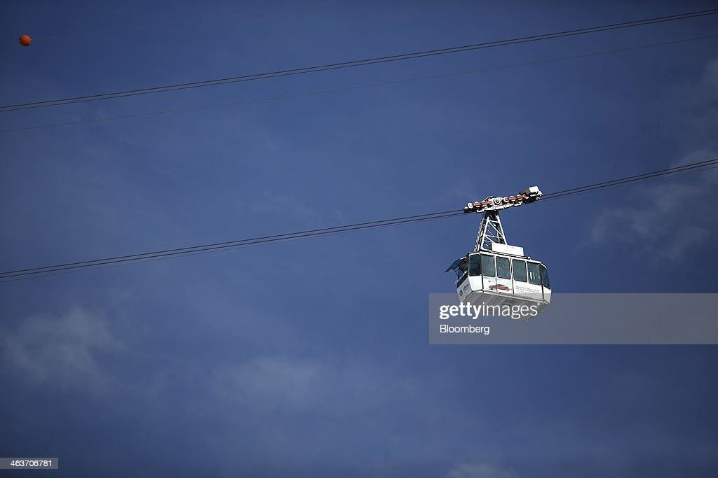 The Jakobshorn cable car is seen against the blue sky as it moves up the mountain from the town of Davos, Switzerland, on Saturday, Jan. 18, 2014. Next week the business elite will gather in the Swiss Alps for the 44th annual meeting of the World Economic Forum (WEF) in Davos for the five day event which runs from Jan. 22-25. Photographer: Simon Dawson/Bloomberg via Getty Images