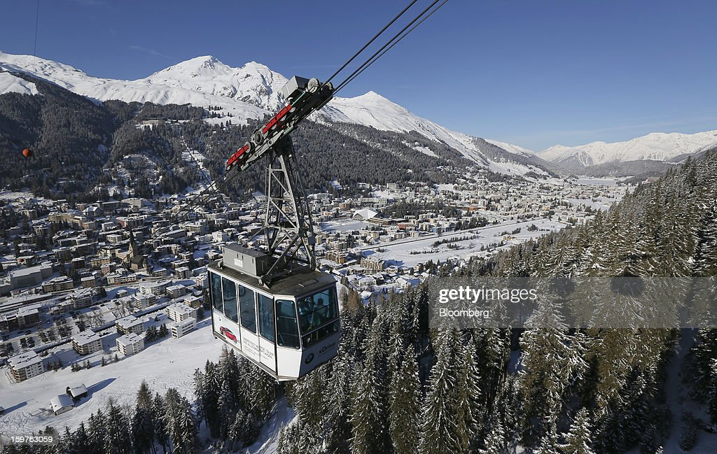 The Jakobshorn cable car moves down the mountain towards the town of Davos, Switzerland, on Friday, Jan. 18, 2013. Next week the business elite gather in the Swiss Alps for the 43rd annual meeting of the World Economic Forum in Davos, the five day event runs from Jan. 23-27. Photographer: Chris Ratcliffe/Bloomberg via Getty Images