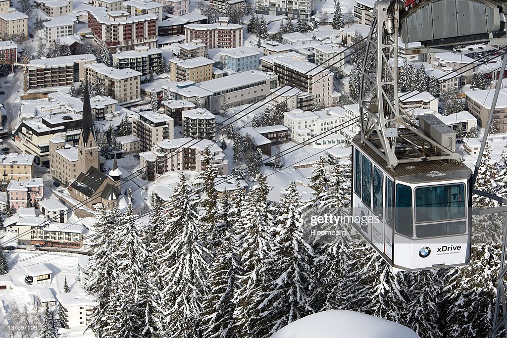 The Jakobshornbahn cable car carries skiers to the slopes above the town of Davos, Switzerland, on Monday, Jan. 23, 2012. German Chancellor Angela Merkel will open this week's World Economic Forum in Davos, Switzerland, which will be attended by policy makers and business leaders including U.S. Treasury Secretary Timothy F. Geithner. Photographer: Scott Eells/Bloomberg via Getty Images