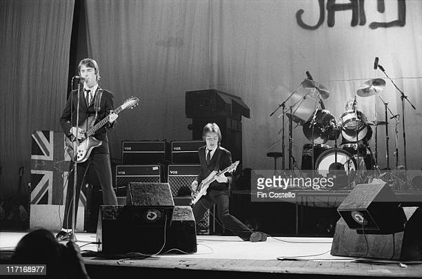guitarist and singer Paul Weller bassist Bruce Foxton and drummer Rick Buckler on stage during a live concert performance at the Hammersmith Odeon in...