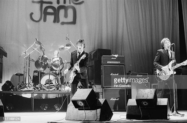 drummer Rick Buckler guitarist and singer Paul Weller and bassist Bruce Foxton on stage during a live concert performance at the Hammersmith Odeon in...