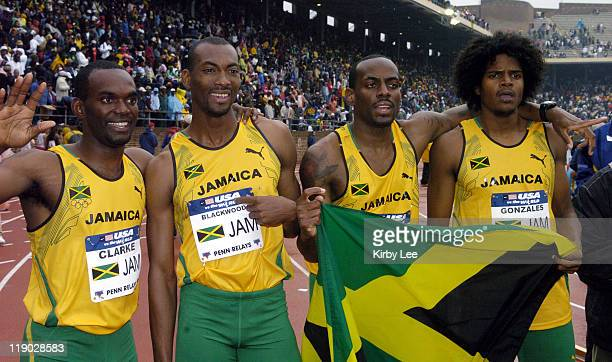 The Jamaica men's 4 x 400meter relay of Davian Clarke Michael Blackwood Sanjay Ayre and Jermaine Gonzales celebrate victory in the USA vs The World...