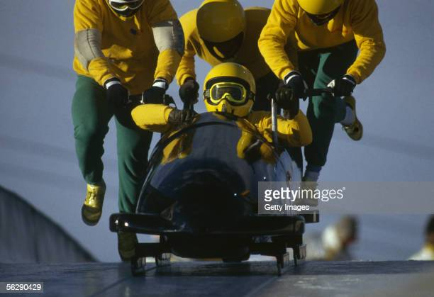 The Jamaican four man bobsleigh team in action at the 1988 Calgary Winter Olympic Games held on February 25 1988 in Calgary Canada