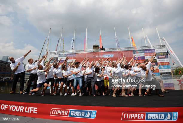 The Jamaican team do a 'Lightning Bolt' on stage during the Round the World Race Finish in London