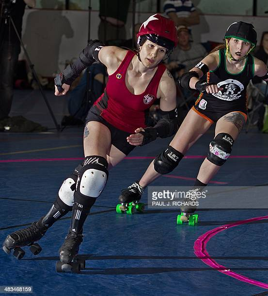 The 'jammers' race each other for points the DC Roller Girls and Rocktown Rollers April 5 2014 during womens flat track Roller Derby at the Dulles...