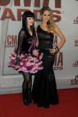 The JaneDear Girls attend the 45th annual CMA Awards at the Bridgestone Arena on November 9 2011 in Nashville Tennessee