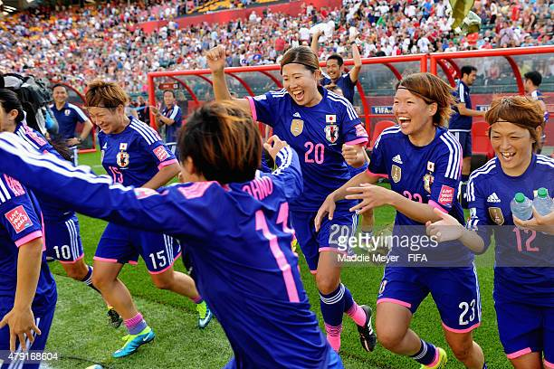The Japan bench including Yuri Kawamura of Japan Kana Kitahara Megumi Kamionobe and Yuika Sugasawa storm the field following their 21 win over...