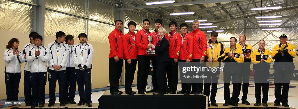 The Japan (Silver), China (Gold) and Australia (Bronze) mens teams pose for a photo during the Pacific Asia 2012 Curling Championship at the Naseby Indoor Curling Arena on November 25, 2012 in Naseby, New Zealand.