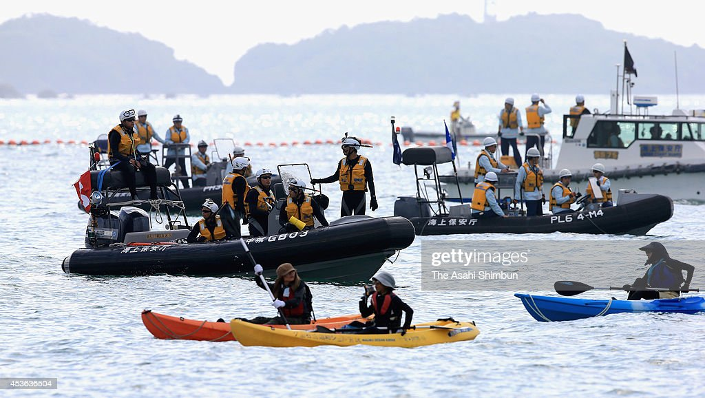 The Japan Coast Guard boat prevents protesters from entering the restricted zone off the Henoko district on August 15, 2014 in Nago, Okinawa, Japan. The boats commissioned by the Okinawa Defense Bureau set up buoys in Oura Bay off Cape Henoko to mark the restricted area above the seabed where the study is planned. Under an agreement between Tokyo and Washington, the U.S. Marine Corps Air Station Futenma, currently in Ginowan, will be relocated to the area off Henoko, despite local opposition to the move.
