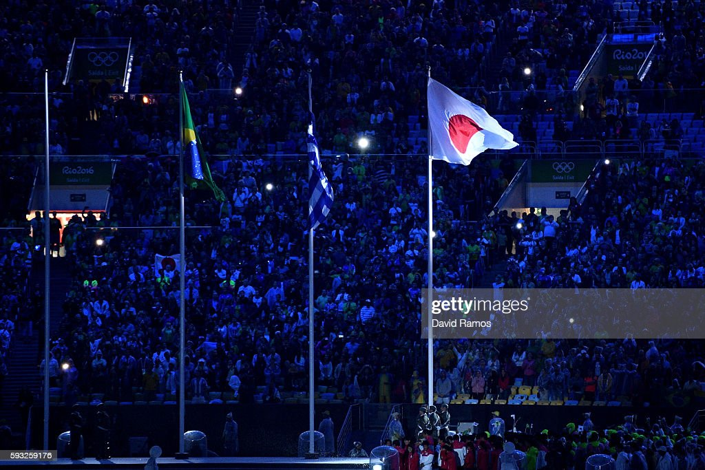The Japan flag is raised after the Flag Handover Ceremony during the Closing Ceremony on Day 16 of the Rio 2016 Olympic Games at Maracana Stadium on...