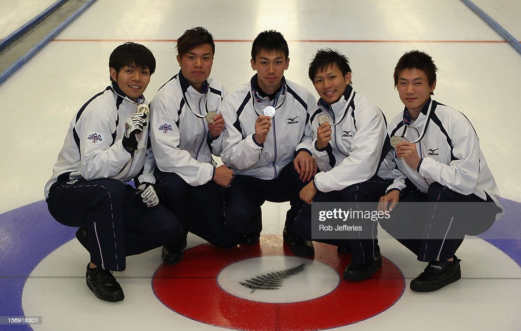 The Japan men's team of Yusuke Morozumi, Tsuyoshi Yamaguchi, Tetsuro Shimizu, Kosuke Morozumi and Yoshiro Shimizu pose for a photo during the Pacific Asia 2012 Curling Championship at the Naseby Indoor Curling Arena on November 25, 2012 in Naseby, New Zealand.