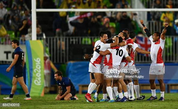 The Japan players celebrate victory during the Men's Rugby Sevens quarter final match between Japan and France on Day five of the Rio 2016 Olympic...