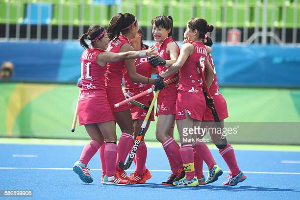 The Japan players celebrate with Mie Nakashima of Japan after she scored a goal during the women's pool B match between Japan and India on Day 2 of...