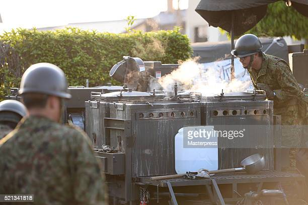 The Japan SelfDefense Forces members operate a souprun at the evacuation center a day after the 2016 Kumamoto Earthquake at the Mashiki Town Hall on...