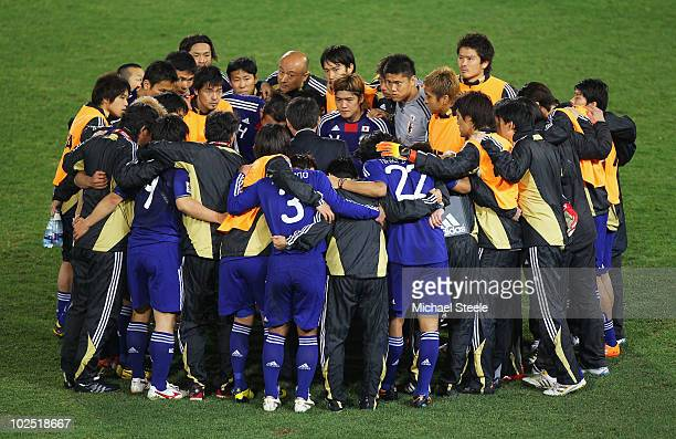 The Japan team and coaching staff huddle ahead of extra time during the 2010 FIFA World Cup South Africa Round of Sixteen match between Paraguay and...