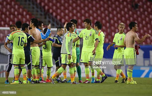 The Japan team celebrate victory during the International Friendly Match between Japan and Costa Rica at Raymond James Stadium on June 2 2014 in...