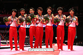The Japan team celebrate winning Gold during day six of the 2015 World Artistic Gymnastics Championships at The SSE Hydro on October 28 2015 in...