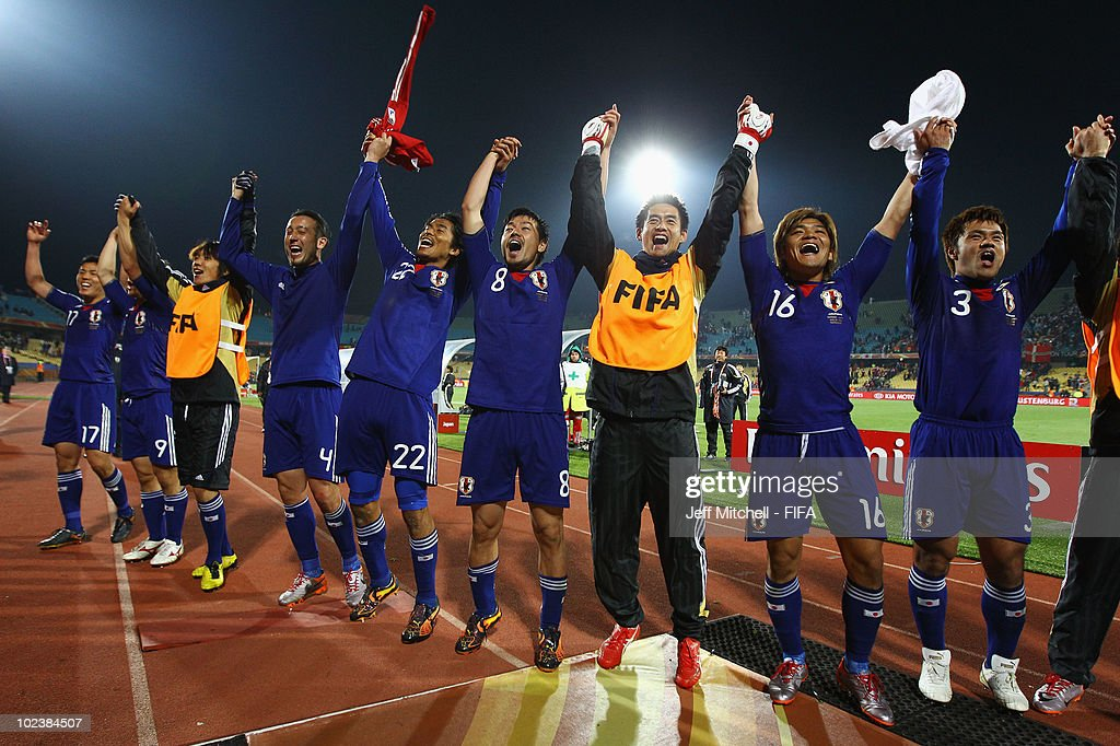 The Japan team celebratein front of the fans after the 2010 FIFA World Cup South Africa Group E match between Denmark and Japan at the Royal Bafokeng...