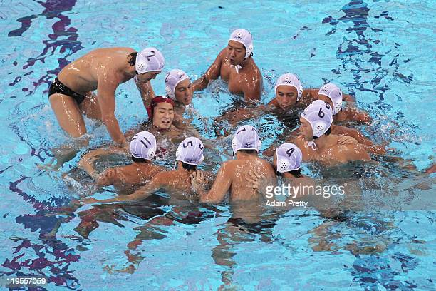 The Japan team huddle during the Men's Water Polo first preliminary round match between Japan and Croatia during Day Seven of the 14th FINA World...