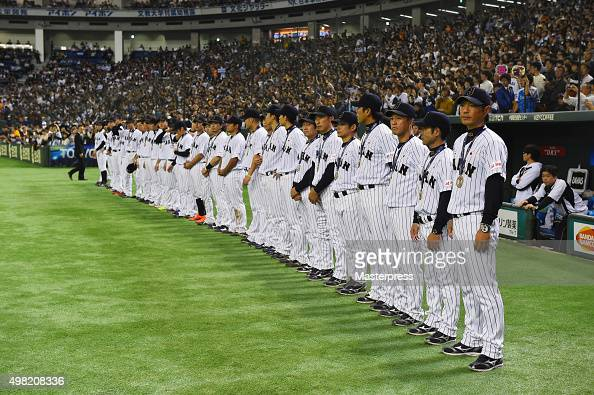 The Japan team line up after winning the WBSC Premier 12 third place play off match between Japan and Mexico at the Tokyo Dome on November 21 2015 in...