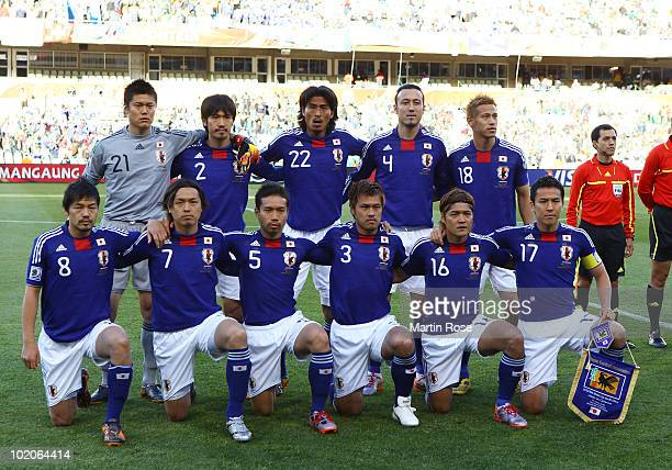 The Japan team line up for a group photo prior to the 2010 FIFA World Cup South Africa Group E match between Japan and Cameroon at the Free State...
