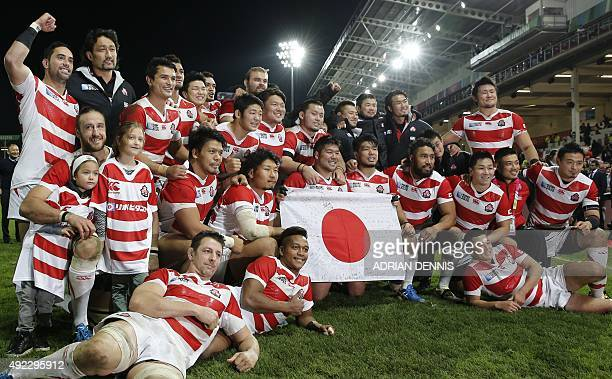 The Japan team pose on the pitch at the end of the Pool B match of the 2015 Rugby World Cup between USA and Japan at Kingsholm stadium in Gloucester...