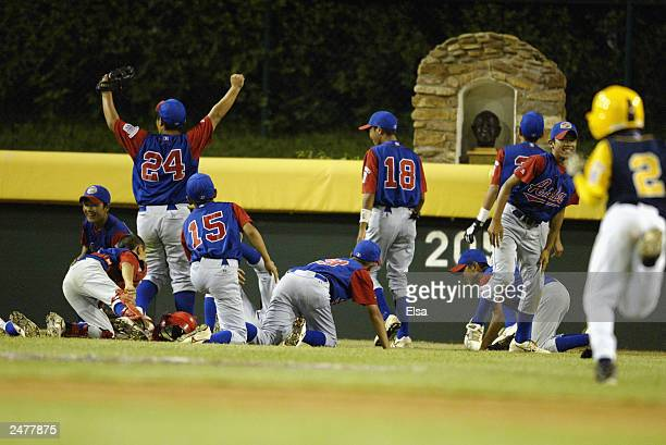 The Japan team runs out to the Howard J Lamade statue in center field after they won World Championship game against Boynton Beach Florida during the...