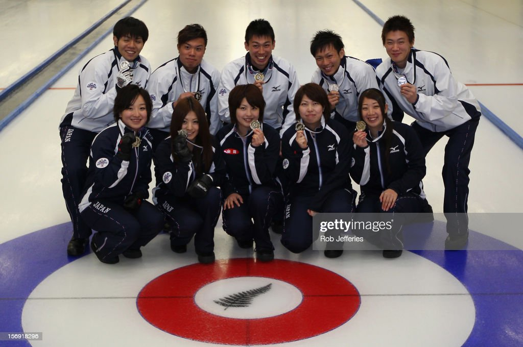 The Japan women and men pose for a photo after winning silver during the Pacific Asia 2012 Curling Championship at the Naseby Indoor Curling Arena on November 25, 2012 in Naseby, New Zealand.