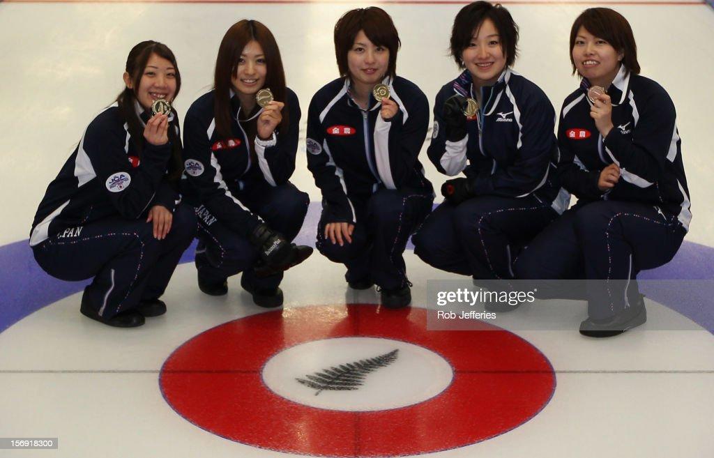 The Japan women's team of Satsuki Fujisawa, Miyo Ichikawa, Emi Shimizu, Chiaki Matsumura and Miyuki Satoh pose for a photo during the Pacific Asia 2012 Curling Championship at the Naseby Indoor Curling Arena on November 25, 2012 in Naseby, New Zealand.