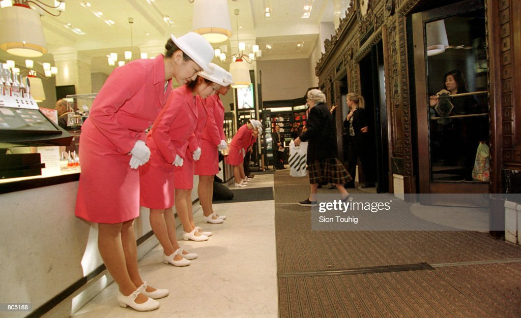 The 'Japanese Elevator Girls' perform their ceremonial ''30 Degree Welcoming Bow'' as the doors open April 30, 2001 at Selfridges Department Store in London, England. The girls perform a ''meet and greet'' role in Japanese department stores, and are in Selfridges to take part in a month long festival of Japanese culture at the store.
