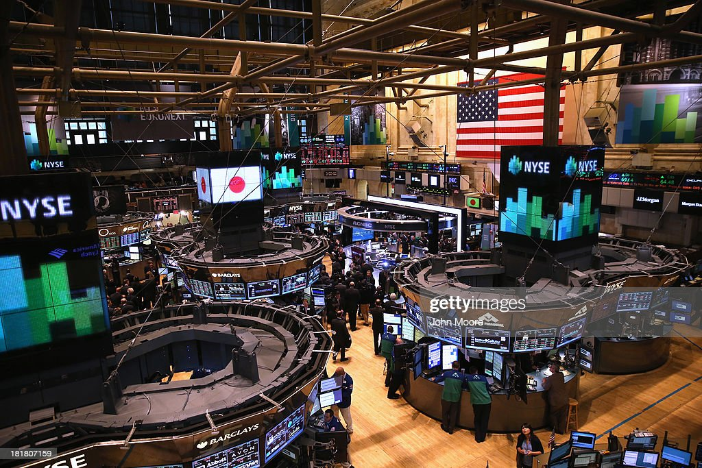 The Japanese flag is displayed over the trading floor before Japanese Prime Minister Shinzo Abe rung the closing bell at the New York Stock Exchange on September 25, 2013 in New York City. Abe gave a speech at the NYSE on 'Abenomics' and his country's economic recovery.