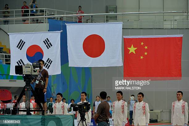 The Japanese flag is raised after Hiroto Hasegawa and Yu Okamoto won gold in the Men's Synchronized 3m Springboard Final at the East Asian Games held...