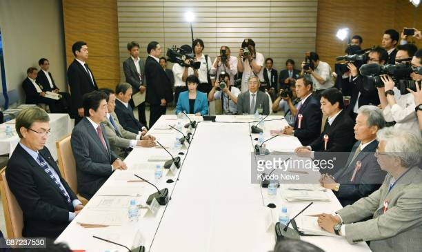 The Japanese government holds a meeting of the Council on Economic and Fiscal Policy in Tokyo on May 23 2017 The government proposed stepping up...