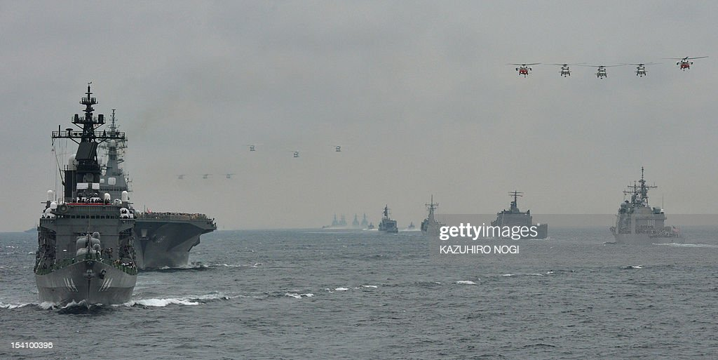 The Japanese Maritime Self-Defense Force (MSDF) escort ship Kurama (L) reviews foreign ships Sydney of Australia (3rd R), Persistence of Singapore (2nd R) and USS Shiloh of the US (R) during its fleet review off Sagami Bay, Japan's Kanagawa prefecture on October 14, 2012. Forty-five MSDF vessels and one ship each from the US, Australian and Singaporean navies participated in the fleet review.